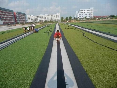 人造草坪足球场铺装-青岛奥兴塑胶铺装有限公司